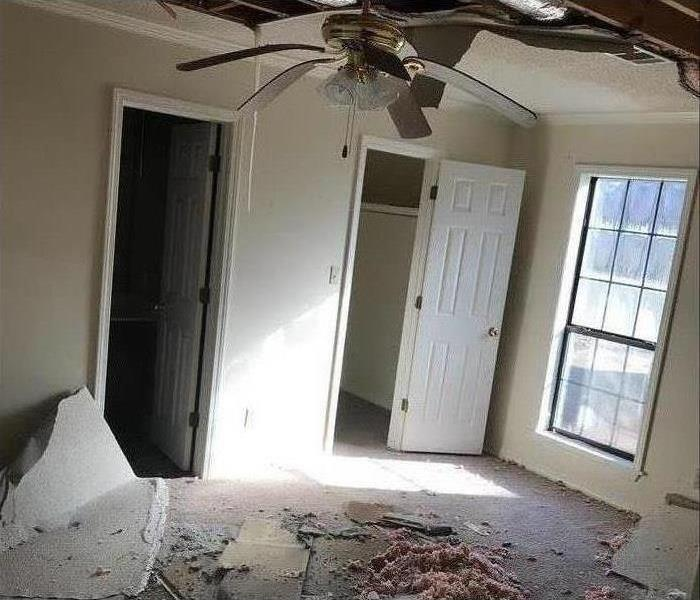 room with debris and sheetrock on the ground